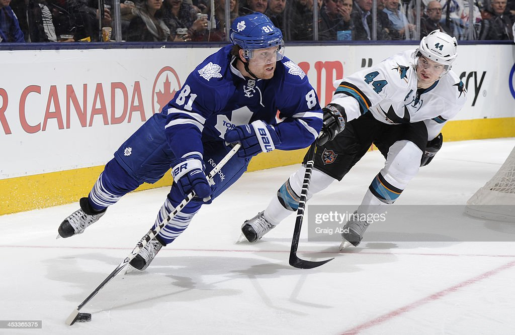 <a gi-track='captionPersonalityLinkClicked' href=/galleries/search?phrase=Phil+Kessel&family=editorial&specificpeople=537794 ng-click='$event.stopPropagation()'>Phil Kessel</a> #81 of the Toronto Maple Leafs skates the puck away from <a gi-track='captionPersonalityLinkClicked' href=/galleries/search?phrase=Marc-Edouard+Vlasic&family=editorial&specificpeople=880807 ng-click='$event.stopPropagation()'>Marc-Edouard Vlasic</a> #44 of the San Jose Sharks during NHL game action December 3, 2013 at the Air Canada Centre in Toronto, Ontario, Canada.
