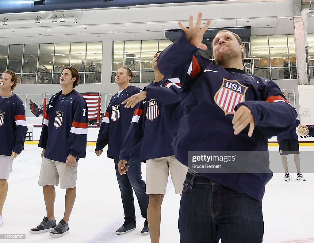 <a gi-track='captionPersonalityLinkClicked' href=/galleries/search?phrase=Phil+Kessel&family=editorial&specificpeople=537794 ng-click='$event.stopPropagation()'>Phil Kessel</a> of the Toronto Maple Leafs throws a tshirt to fans following a press conference introducing the 2014 USA Hockey Olympic Team candidates at the Kettler Capitals Iceplex on August 27, 2013 in Arlington, Virginia.