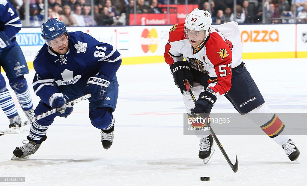 Phil Kessel #81 of the Toronto Maple Leafs tries to keep up with Marcel Goc #57 of the Florida Panthers during NHL action at the Air Canada Centre March 26, 2013 in Toronto, Ontario, Canada.