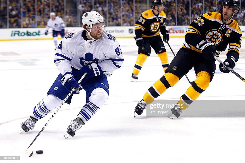 <a gi-track='captionPersonalityLinkClicked' href=/galleries/search?phrase=Phil+Kessel&family=editorial&specificpeople=537794 ng-click='$event.stopPropagation()'>Phil Kessel</a> #81 of the Toronto Maple Leafs works around <a gi-track='captionPersonalityLinkClicked' href=/galleries/search?phrase=Zdeno+Chara&family=editorial&specificpeople=203177 ng-click='$event.stopPropagation()'>Zdeno Chara</a> #33 of the Boston Bruins in the third period during Game Two of the Eastern Conference Quarterfinals during the 2013 NHL Stanley Cup Playoffs at TD Garden on May 4, 2013 in Boston, Massachusetts.