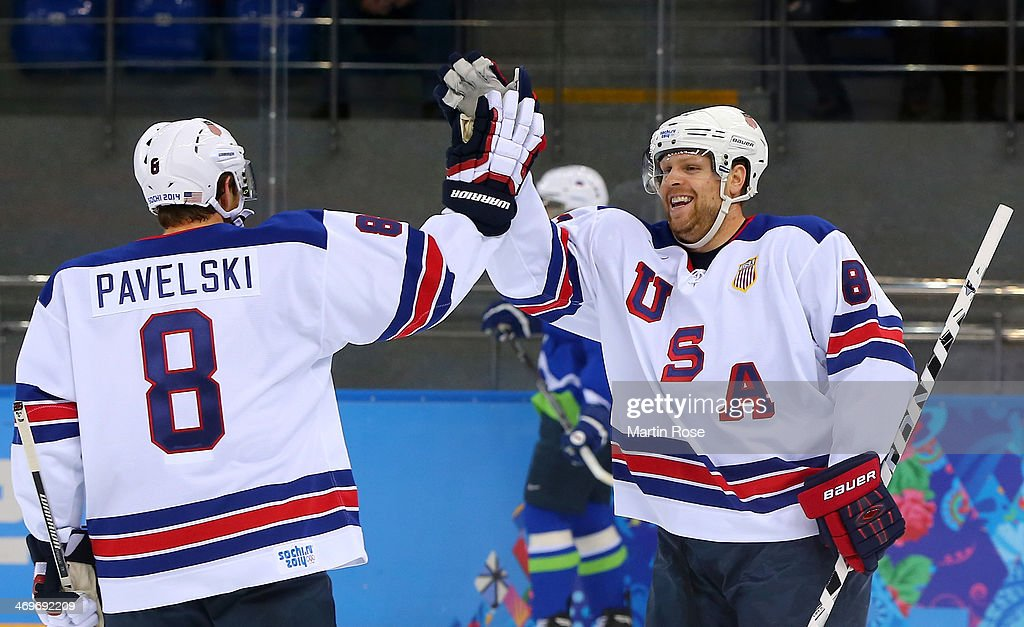 <a gi-track='captionPersonalityLinkClicked' href=/galleries/search?phrase=Phil+Kessel&family=editorial&specificpeople=537794 ng-click='$event.stopPropagation()'>Phil Kessel</a> #81 of the United States celebrates with <a gi-track='captionPersonalityLinkClicked' href=/galleries/search?phrase=Joe+Pavelski&family=editorial&specificpeople=687042 ng-click='$event.stopPropagation()'>Joe Pavelski</a> #8 of the United States after scoring his second goal in the first period against Slovenia, both assisted by Pavelski, during the Men's Ice Hockey Preliminary Round Group A game on day nine of the Sochi 2014 Winter Olympics at Shayba Arena on February 16, 2014 in Sochi, Russia.