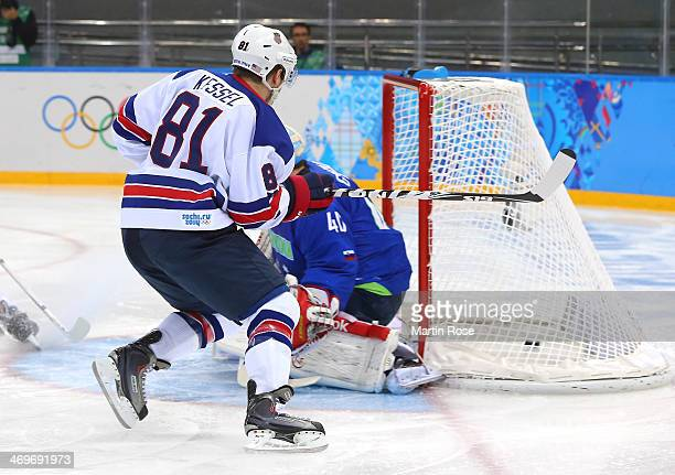 Phil Kessel of the United States scores against Luka Gracnar of Slovenia in the first period during the Men's Ice Hockey Preliminary Round Group A...