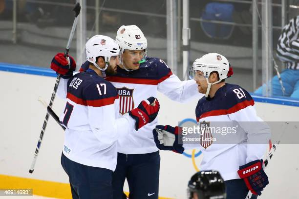 Phil Kessel of United States celebrates with teammates after scoring a goal against Jaroslav Halak of Slovakia in the second period during the Men's...