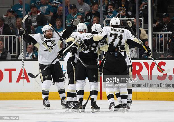Phil Kessel Patric Hornqvist Kris Letang and Evgeni Malkin of the Pittsburgh Penguins celebrate Malkin's second period goal against the San Jose...