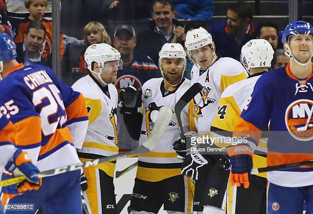 Phil Kessel Trevor Daley and Evgeni Malkin of the Pittsburgh Penguins celebrate Daley's second period goal against the New York Islanders at the...