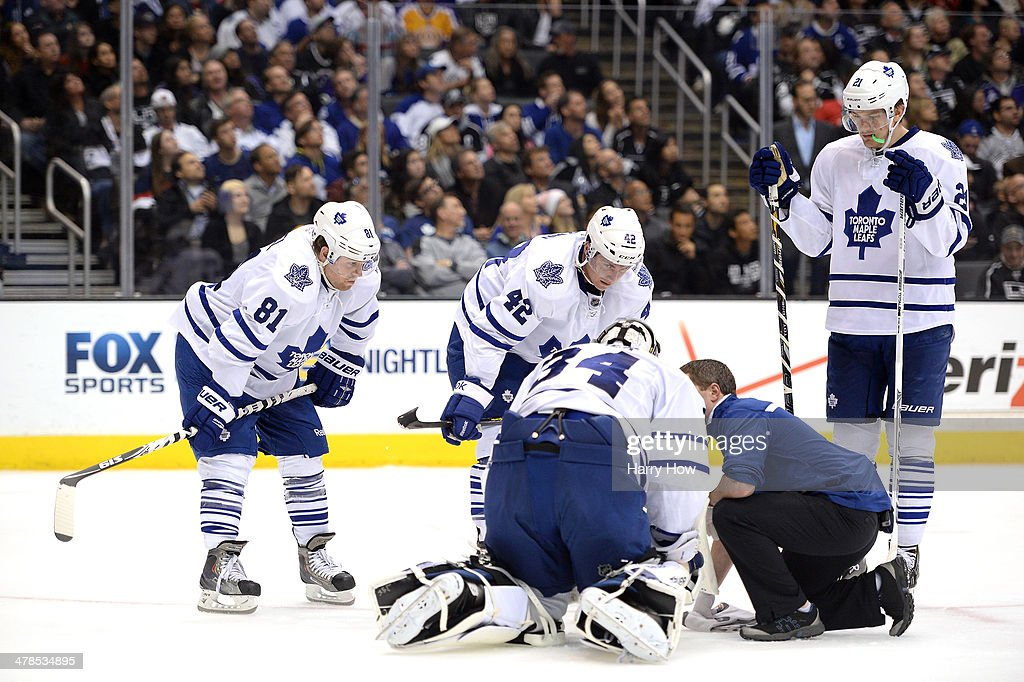 <a gi-track='captionPersonalityLinkClicked' href=/galleries/search?phrase=Phil+Kessel&family=editorial&specificpeople=537794 ng-click='$event.stopPropagation()'>Phil Kessel</a> #81, <a gi-track='captionPersonalityLinkClicked' href=/galleries/search?phrase=Tyler+Bozak&family=editorial&specificpeople=6183313 ng-click='$event.stopPropagation()'>Tyler Bozak</a> #42 and James van Riemsdyk #21 of the Toronto Maple Leafs watch as James Reimer #34 gets medical attention during the second period against the Los Angeles Kings at Staples Center on March 13, 2014 in Los Angeles, California.