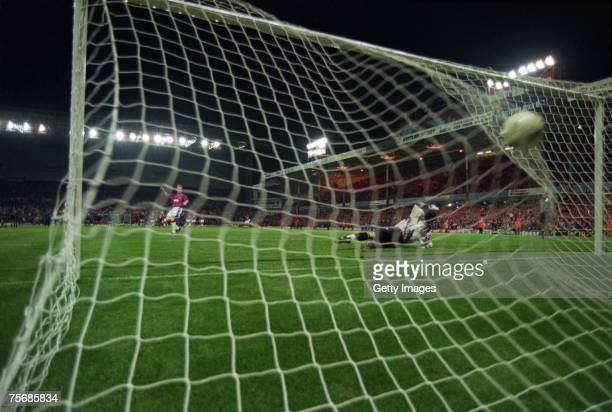Phil King of Aston Villa scores the winning goal during a penalty shoot out against Inter Milan in the second leg of the 1st round UEFA Cup tie Villa...