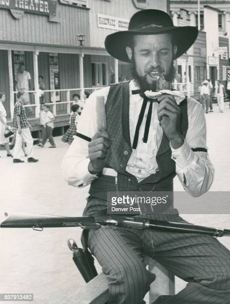 Phil Lalena deputy sheriff of Pioneer Village attempts to escape Friday's scorching 87degrees heat with a popsicle an ice cream bar Centennial...