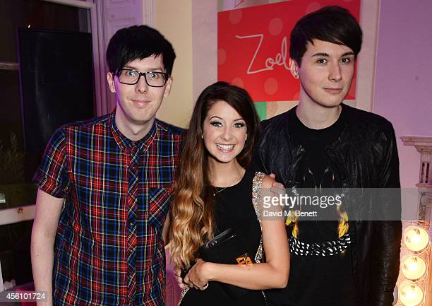 Phil Lester Zoe Sugg and Dan Howell attend YouTube phenomenon Zoe Sugg's launch of her debut beauty collection at 41 Portland Place on September 25...