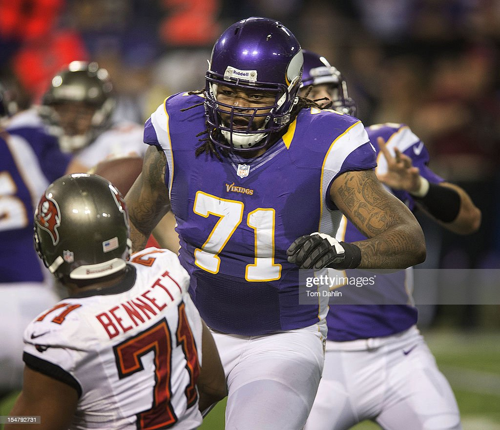 Phil Loadholt #71 of the Minnesota Vikings blocks during an NFL game against the Tampa Bay Buccaneers at Mall of America Field at the Hubert H. Humphrey Metrodome on October 25, 2012 in Minneapolis, Minnesota.