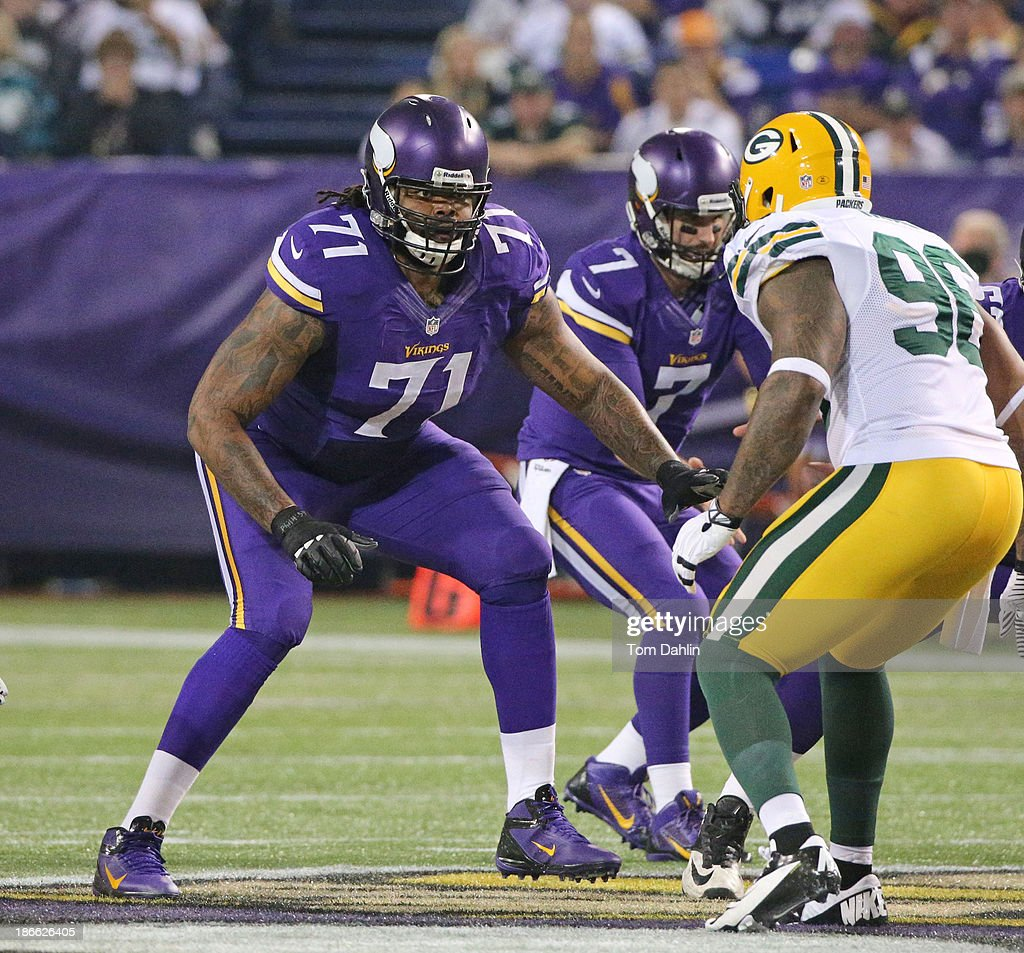 Phil Loadholt #71 of the Minnesota Vikings blocks during an NFL game against the Green Bay Packers at Mall of America Field at the Hubert H. Humphrey Metrodome on October 27, 2013 in Minneapolis, Minnesota.