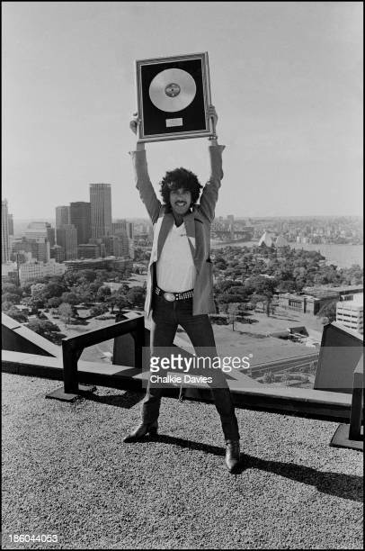 Phil Lynott from Thin Lizzy holds a gold disc above his head in Sydney Australia in 1978