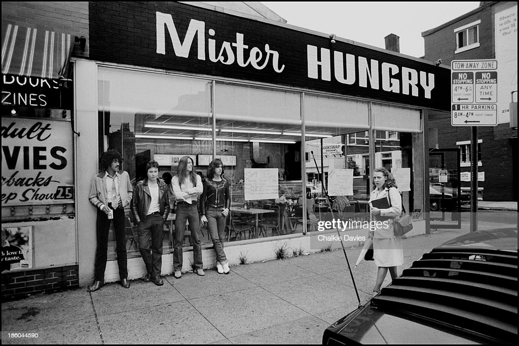 Phil Lynott Scott Gorham and Gary Moore from Thin Lizzy pose with NME journalist Tony Parsons in Philadelphia 1978