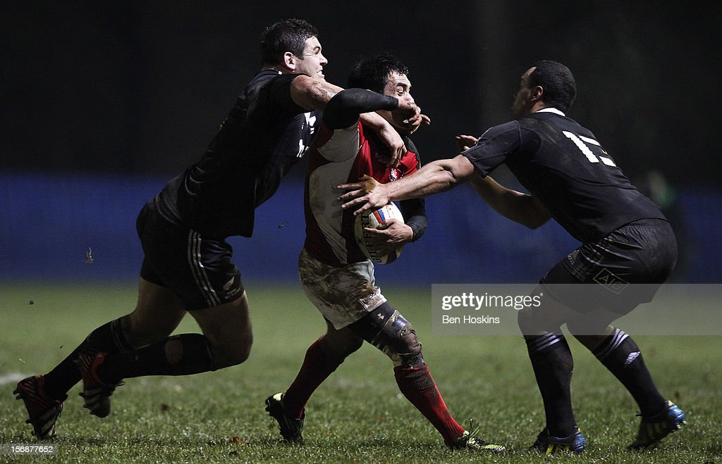 Phil Mack of Canada is tackled by Romana Graham (L) and Charlie Ngatai (R) of the Maori All Blacks during a tour match between Canada and Maori All Blacks at Oxford University Rugby Club on November 23, 2012 in Oxford, England.
