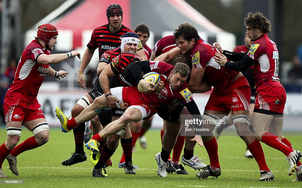 Phil MacKenzie of London Welsh is tackled during the Aviva Premiership match between Saracens and London Welsh at Allianz Park on March 03, 2013 in Barnet, England.