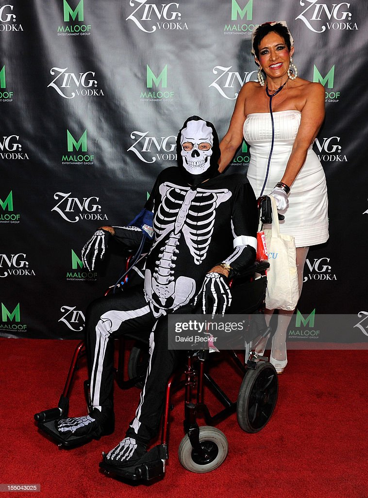 Phil Maloof Sr. (L) and Toni Hodges arrive at the ZING Vodka's Las Vegas Launch Party at Gavin Maloof's home on October 30, 2012 in Las Vegas, Nevada.