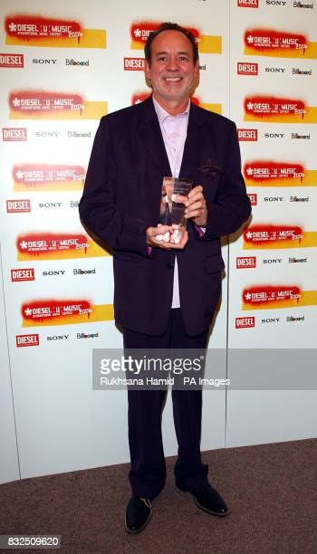 Phil Manzanera of Roxy Music poses with their Channel 4 Radio Icon award at the Diesel UMusic Awards ceremony at Shoreditch Town Hall in London on...