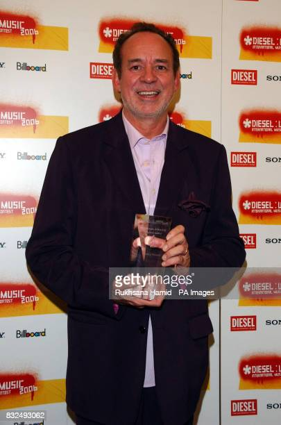 Phil Manzanera of Roxy Music poses with their for Channel 4 Radio Music Icon at the Diesel UMusic Awards at Shoreditch Town Hall east London