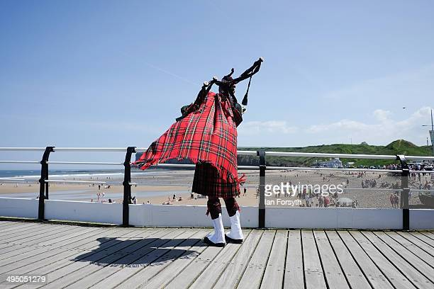 Phil Meadows from the Teesside Pipe Band plays bagpipes on Saltburn pier during a commemoration event to remember the World War one truce football...