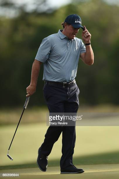 Phil Mickelson acknowledges the crowd following a putt on the 10th green during the first round of the Shell Houston Open at the Golf Club of Houston...