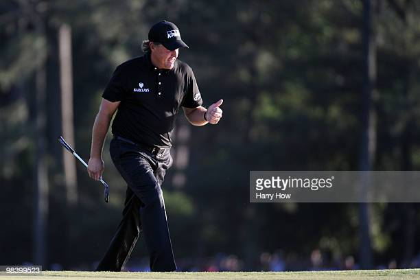 Phil Mickelson acknowledges the gallery on the 18th hole during the final round of the 2010 Masters Tournament at Augusta National Golf Club on April...