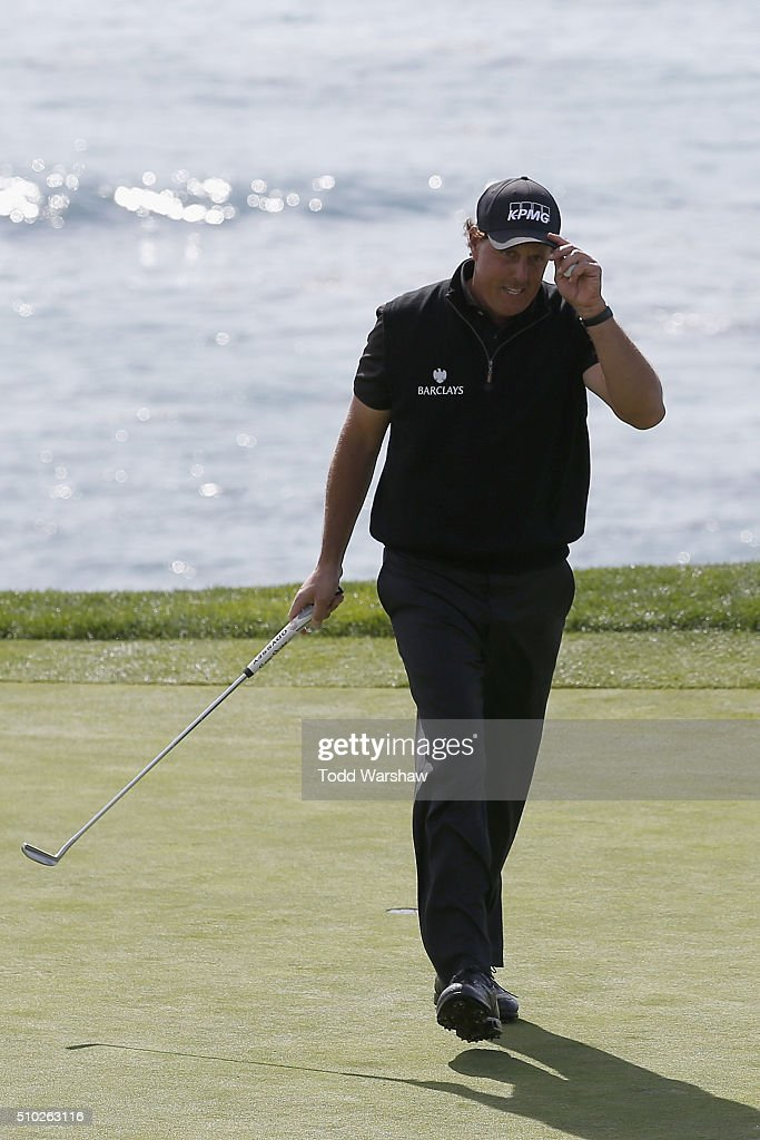 <a gi-track='captionPersonalityLinkClicked' href=/galleries/search?phrase=Phil+Mickelson&family=editorial&specificpeople=157543 ng-click='$event.stopPropagation()'>Phil Mickelson</a> acknowledges the gallery on the eighth green during the final round of the AT&T Pebble Beach National Pro-Am at the Pebble Beach Golf Links on February 14, 2016 in Pebble Beach, California.