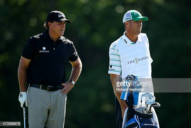 Phil Mickelson and caddie Jim 'Bones' Mackay prepare to play his second shot on the 14th hole during round two of THE PLAYERS Championship at the TPC...