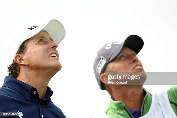 Phil Mickelson and his caddie Jim 'Bones' MacKay look up during the third round of the 110th US Open at Pebble Beach Golf Links on June 19 2010 in...