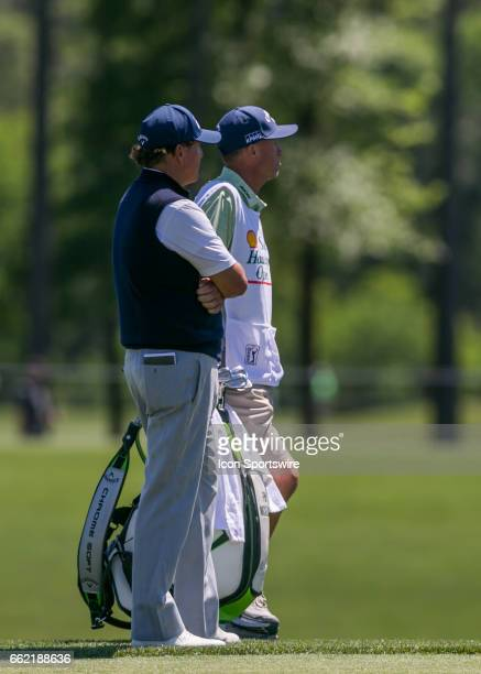 Phil Mickelson and his caddie Jim 'Bones' Mackay wait for the green to clear on 2 during Round 2 of the PGA Shell Houston Open on March 31 2017 at...