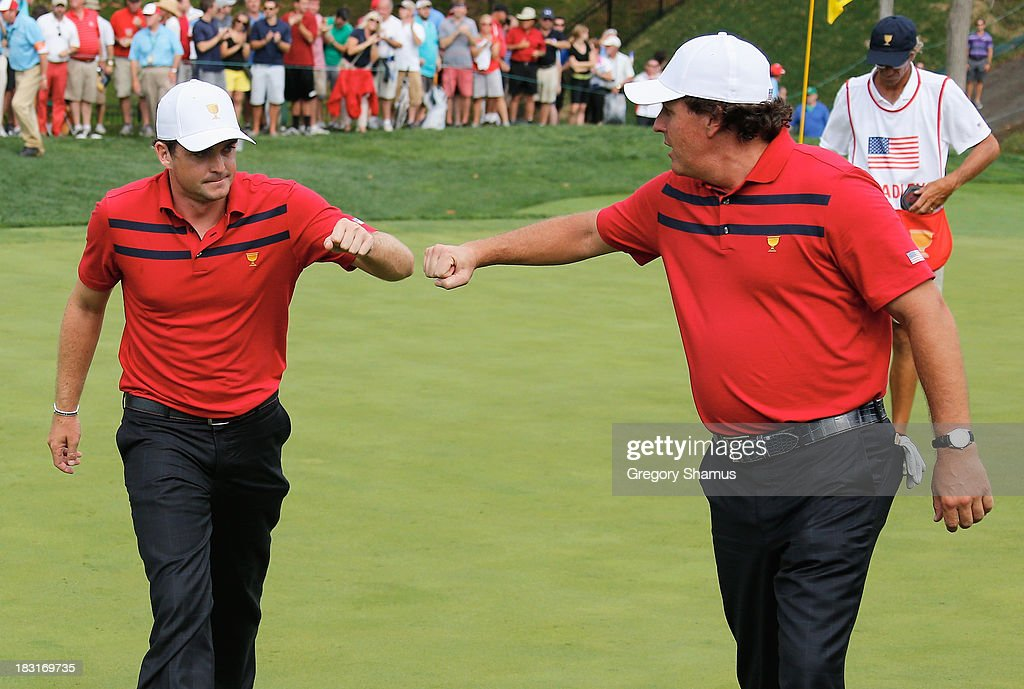 Phil Mickelson and Keegan Bradley of the U.S. Team celebrate after a birdie on the 15th green during the Day Three Four-ball Matches at the Muirfield Village Golf Club on October 5, 2013 in Dublin, Ohio.