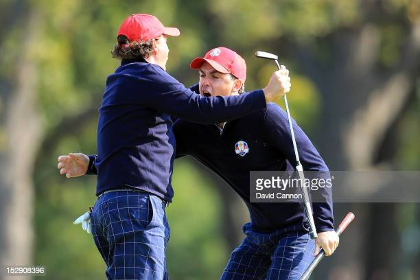 Phil Mickelson and Keegan Bradley of the USA celebrate on the 12th hole during the Morning Foursome Matches for The 39th Ryder Cup at Medinah Country...