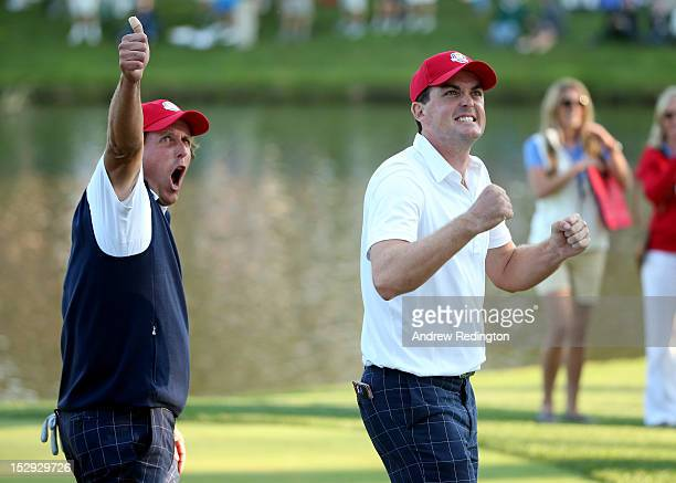Phil Mickelson and Keegan Bradley of the USA celebrate on the 17th green after defeating the McIlroy/McDowell team 21 during the Afternoon FourBall...