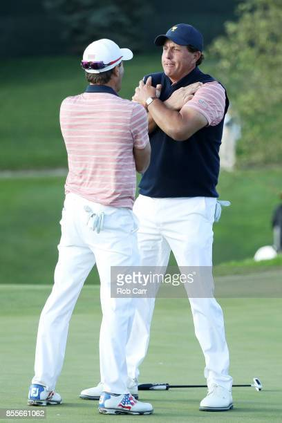 Phil Mickelson and Kevin Kisner of the US Team celebrate on the 18th green after going one up against Marc Leishman and Jason Day of Australia and...
