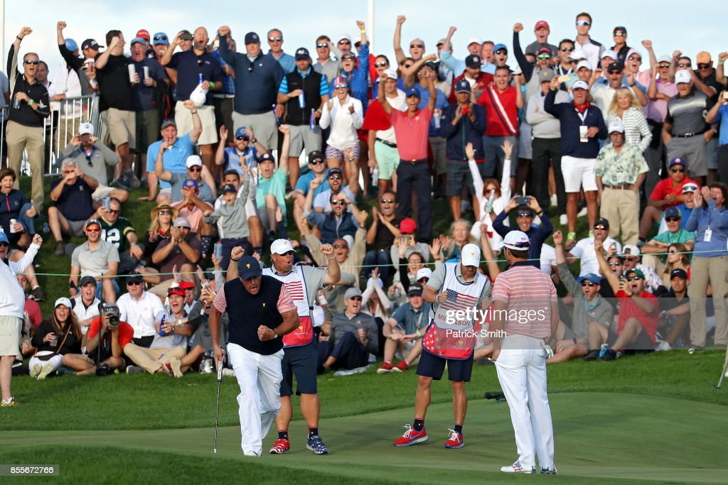 Phil Mickelson and Kevin Kisner of the U.S. Team celebrate on the 18th green after going one up against Marc Leishman and Jason Day of Australia and the International Team during Friday four-ball matches of the Presidents Cup at Liberty National Golf Club on September 29, 2017 in Jersey City, New Jersey.