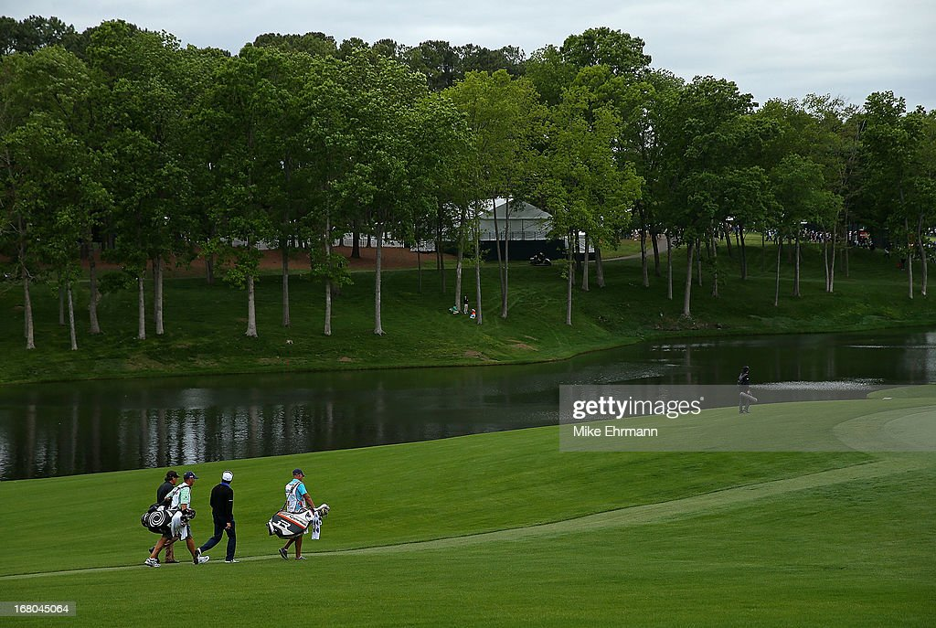 Phil Mickelson and Scott Gardiner of Australia walk up the 15th hole during the third round of the Wells Fargo Championship at Quail Hollow Club on May 4, 2013 in Charlotte, North Carolina.