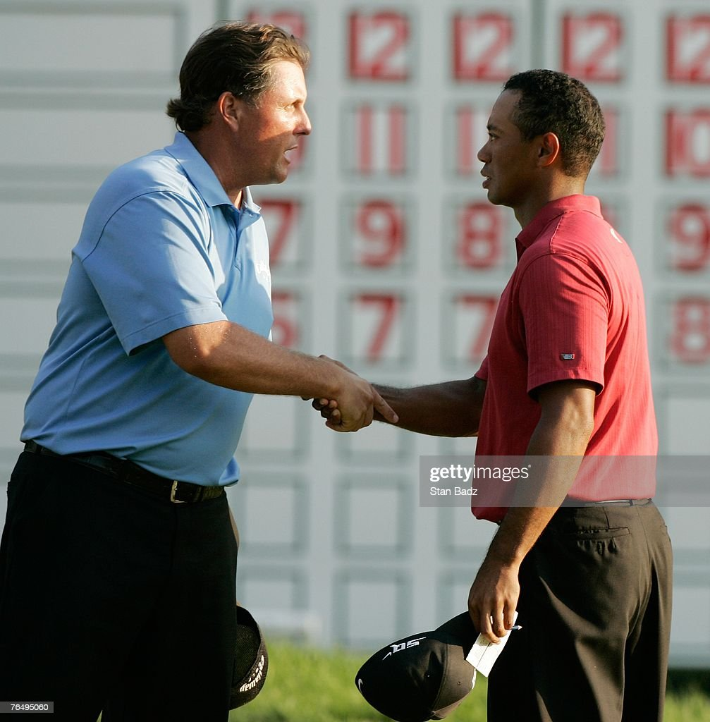 Phil Mickelson and Tiger Woods handshake at the 18th green after the fourth round of the Deutsche Bank Championship the second event of the new PGA...