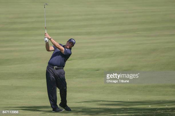 Phil Mickelson approaches the green of the 14th hole during the first round of the BMW Championship on Thursday Sept 14 at Conway Farms Golf Club in...