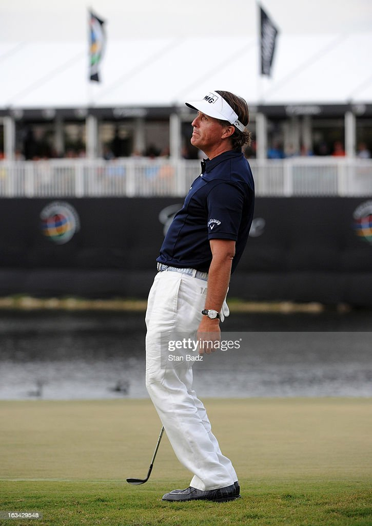 Phil Mickelson bends at the knees after missing a putt on the 18th green during the third round of the World Golf Championships-Cadillac Championship at TPC Blue Monster at Doral on March 9, 2013 in Doral, Florida.