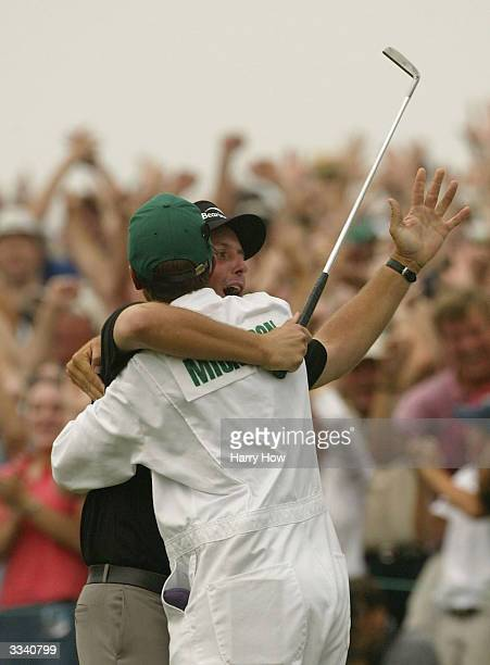 Phil Mickelson celebrates a onestroke victory with his caddie Jim MacKay on the 18th green during the final round of the Masters at the Augusta...