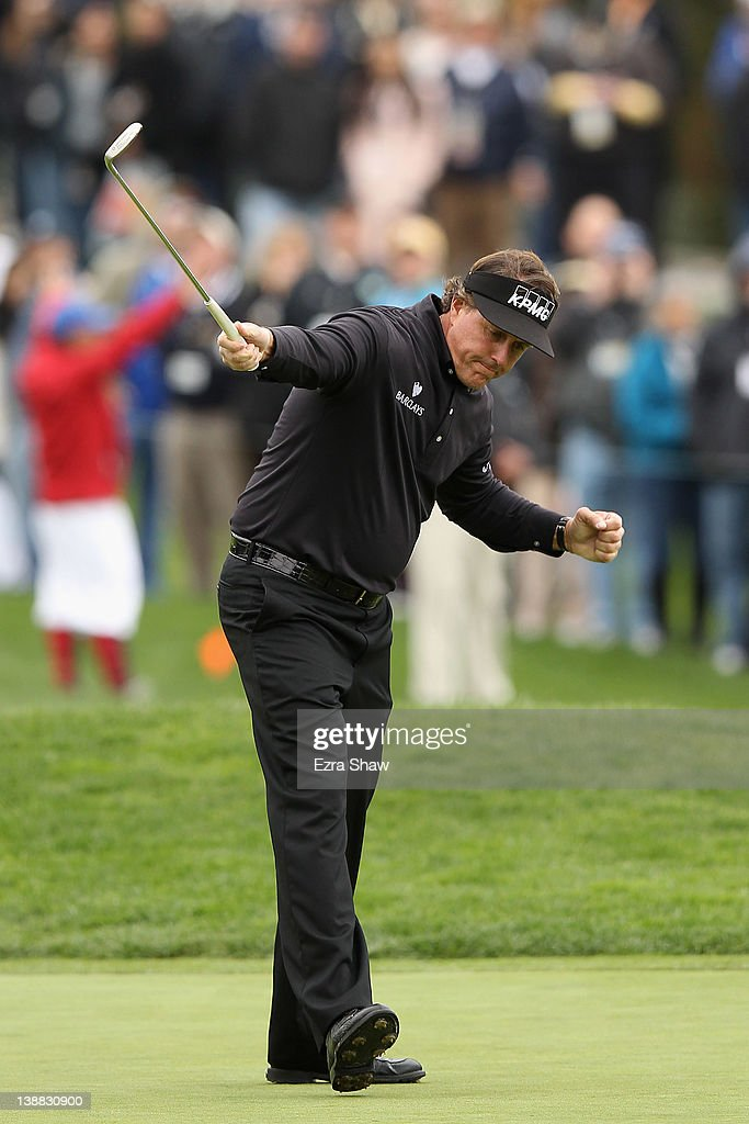 Phil Mickelson celebrates his par-saving putt on the 15th hole during the final round of the AT&T Pebble Beach National Pro-Am at Pebble Beach Golf Links on February 12, 2012 in Pebble Beach, California. Mickelson won with an eight-under-par 64.
