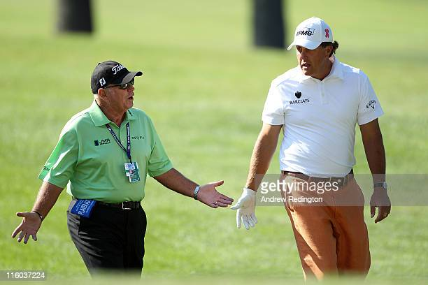 Phil Mickelson chats with his coach Butch Harmon during a practice round prior to the start of the 111th US Open at Congressional Country Club on...