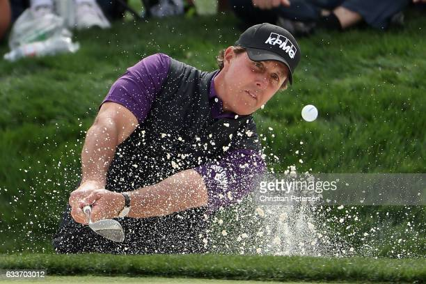 Phil Mickelson chips from the bunker onto the ninth green during the second round of the Waste Management Phoenix Open at TPC Scottsdale on February...