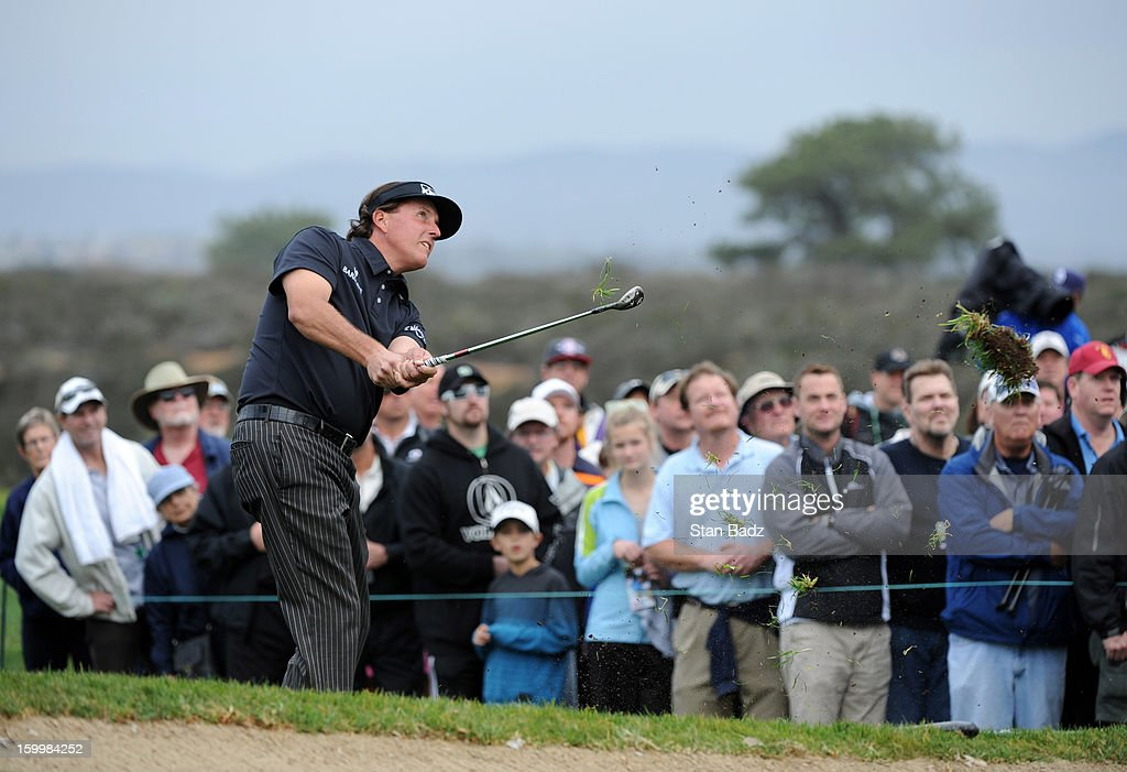 Phil Mickelson chips onto the 12th green during the first round of the Farmers Insurance Open at Torrey Pines Golf Course on January 24, 2013 in La Jolla, California.