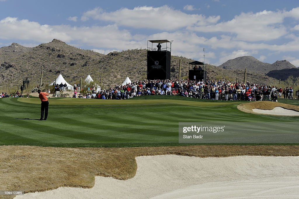 Phil Mickelson chips onto the eighth green during the second round of the World Golf Championships-Accenture Match Play Championship at The Ritz-Carlton Golf Club, Dove Mountain on February 24, 2011 in Marana, Arizona.