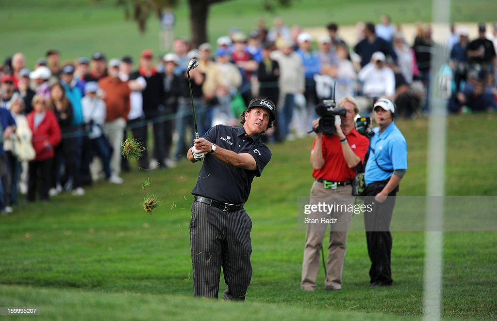 Phil Mickelson chips onto the ninth green during the first round of the Farmers Insurance Open at Torrey Pines Golf Course on January 24, 2013 in La Jolla, California.