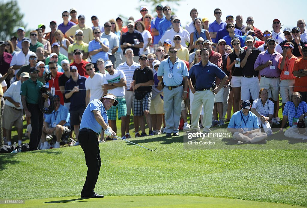 <a gi-track='captionPersonalityLinkClicked' href=/galleries/search?phrase=Phil+Mickelson&family=editorial&specificpeople=157543 ng-click='$event.stopPropagation()'>Phil Mickelson</a> chips to the 16th green during the final round of The Barclays at Liberty National Golf Club on August 25, 2013 in Jersey City, New Jersey.