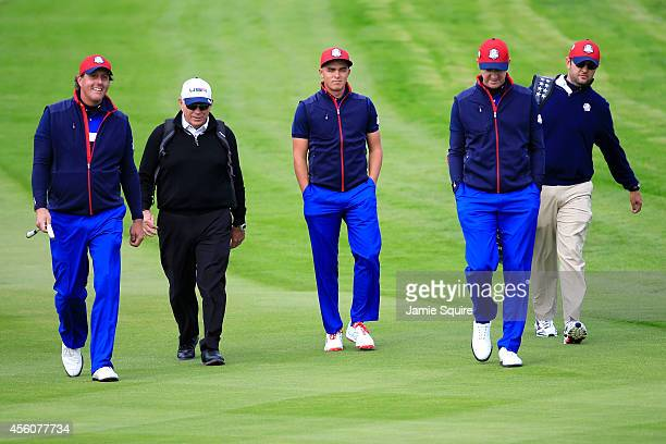 Phil Mickelson coach Butch Harmon Rickie Fowler Jimmy Walker of the United States and caddie Andy Sanders walk the course during practice ahead of...