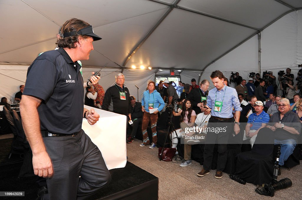 Phil Mickelson exits the media center after his press interview at the Farmers Insurance Open at Torrey Pines Golf Course on January 23, 2013 in La Jolla, California.