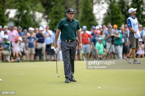 Phil Mickelson eyes a putt during 1st round action at the PGA Championship at the Quail Hollow Club on August 10 2017 in Charlotte NC