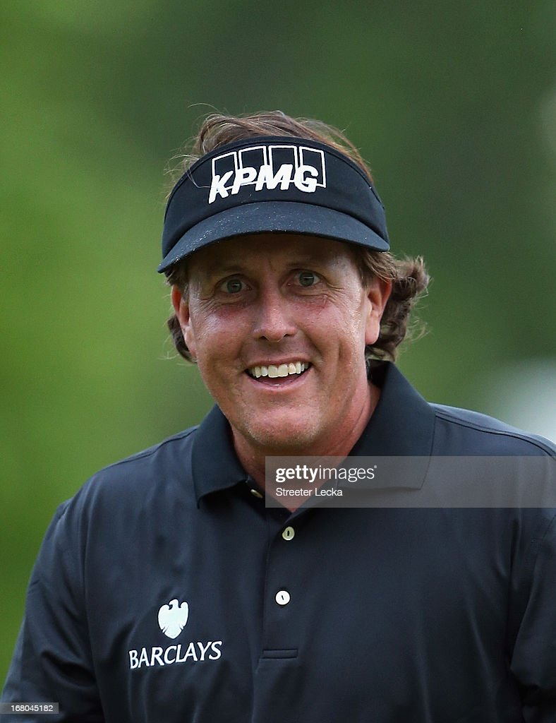 Phil Mickelson finishes on the 18th green during the third round of the Wells Fargo Championship at Quail Hollow Club on May 4, 2013 in Charlotte, North Carolina.